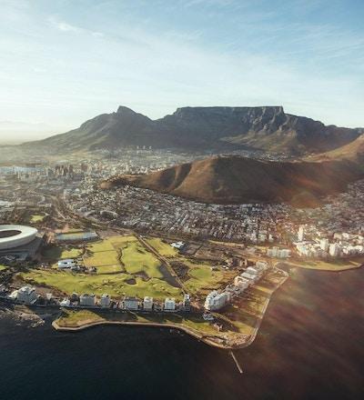 Flygfoto över Kapstaden med Cape Town Stadium, Lion Head och Table Mountain.