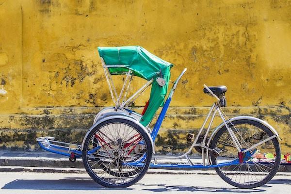 Trehjuling som används för att transportera turister runt den UNESCO-listade antika staden Hoi An, centrala Vietnam.