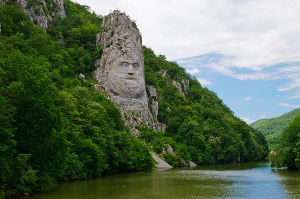 Carved portrait of Dacian king Decebal on Danube river ,Iron Gates Natural Park, Romania