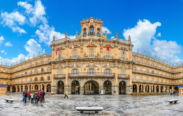 Famous and historic  Plaza Mayor in Salamanca on a sunny day with dramatic clouds, Castilla y Leon, Spain