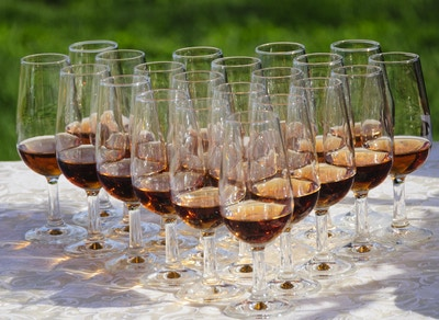 Wineglasses with port wine on a table outdoors